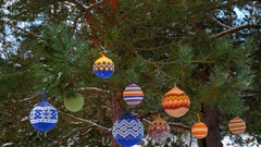 Christmas balls hanging on pine branches covered with snow Stock Footage