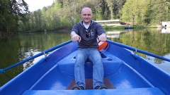 A man in a boat rowing paddles Stock Footage