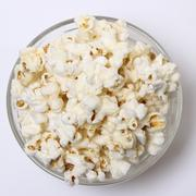 Salty popcorn on a white background Stock Photos