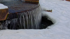 Ice icicles on a freezing fountain in winter Stock Footage