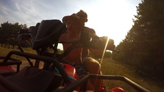4K footage:  son with father riding by the quadrocycle front camera view Stock Footage