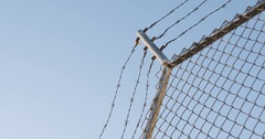 Barbed Wire Fence - establishing shot - looking up - New York City - 4k Stock Footage