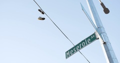 Sneakers hanging over a telephone line in Brooklyn, NYC - 4k Stock Footage