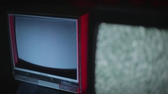 Retro TVs in a dark room | rack focus Stock Footage