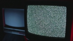 Retro TVs in a dark room | Static TV OFF Stock Footage
