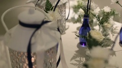 Wedding table decorated with roses, candles and photos Stock Footage