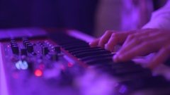 Hands of men play on the synth Stock Footage