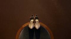 White vintage wedding heels on the old luxury chair Stock Footage