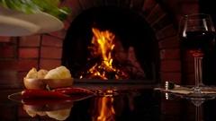 Celebratory dinner by the fireplace. Stock Footage