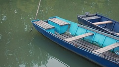 Old fishing rowing-boats at the pier on the water. Arkistovideo