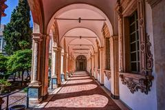 Image of the cloister arches inside a monastery Stock Photos