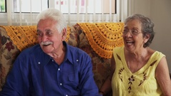 Group Of Happy Friends Laughing And Talking In Retirement Home Stock Footage