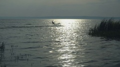 Kitesurfer on the lake in autumn enjoy extreme sport Stock Footage