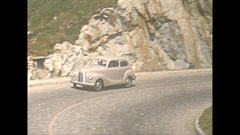 Vintage 16mm film, 1952, Switzerland, steep twisty mountain highway traffic Stock Footage