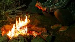4K.Man  heat hands near  bonfire close up. Autumn travel life.  Stock Footage