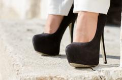 Close up at the back high heels, standing on the steps. Horizontal photo Stock Photos