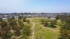 4k aerial video of flying toward resdiential houses in a suburb Stock Footage