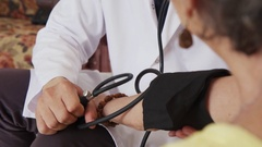 Blood Pressure Equipment And Old Woman As Patient In Clinic Stock Footage