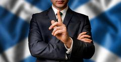 Scottish candidate speaks to the people crowd with one finger on lips Stock Photos