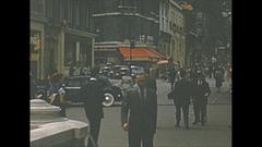 Vintage 16mm film, 1952, France, Paris, streetlife #6 people busy traffic Stock Footage