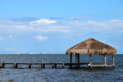 Thatched Cabana on Dock with Cancun on the Horizon Kuvituskuvat