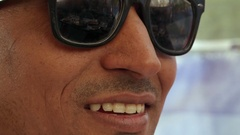 Extreme closeup of a handsome  dude male wearing dark glasses, smug, sexy and co Stock Footage