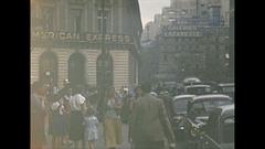 Vintage 16mm film, 1952, France, Paris, streetlife #1 people traffic nuns Stock Footage