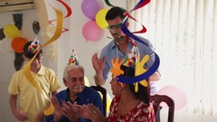 Birthday Party For Happy Old Man In Retirement Home Stock Footage
