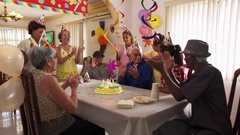 Family Reunion For Birthday Party Celebration In Retirement Home Stock Footage