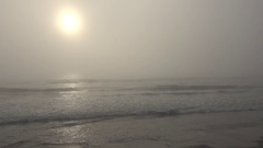 4K Amazing sea wave splash in heavy fog sun silhouette seascape bad weather day Stock Footage