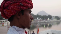 Portrait of a handsome Rajasthani man by the holy Pushkar Lake in India  Stock Footage