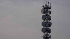 4K Closeup broadband antenna pylon in cloudy day engineering receiver tower pole Stock Footage