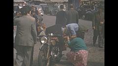 Vintage 16mm film, 1952, France, Paris, streetlife, on street motorbike... Stock Footage