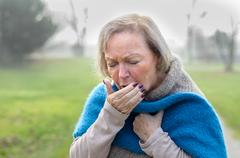 Elderly stylish woman coughing or sneezing Stock Photos