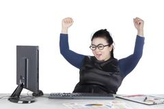 Happy businesswoman lifting hands Stock Photos