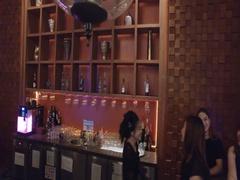 Smiling asian bar tenders at hotel bar Stock Footage