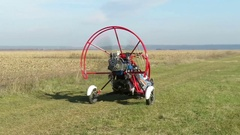 Motorized paraglider moving on airfield Stock Footage