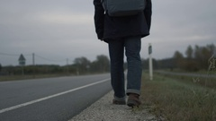 Casualy Dressed Traveler Sitting by the Highway at a Cloudy Day. Stock Footage