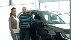 Happy couple with their newly bought car Arkistovideo