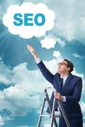 Businessman in SEO search engine optimization concept Stock Photos