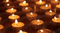 Lots of candles burning  with shimmery flames Stock Footage