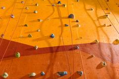 Close up of orange climbing wall Stock Photos
