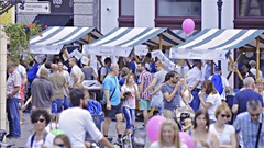 Visiting stalls in crowded city long shot 4K Stock Footage