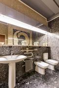 Ethnic bathroom with sink and big mirror Stock Photos