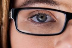 Beautiful eye of a woman wearing spectacles Stock Photos