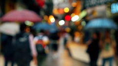 Macao - Defocused people with umbrellas walking in Historic Centre of Macao. 4K Stock Footage