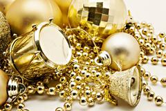 Christmas gold decoration, balls, beads, bell close up isolated Stock Photos