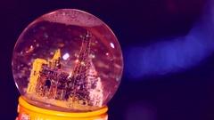 Snow globe on the dark background Stock Footage