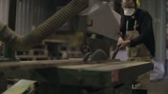 Hardwood Flooring Workshop - Sawing a Length of Timber Stock Footage