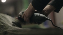Cleaning the Surface of a Log with a Wire Brush Stock Footage